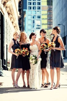 Maids in black with gorgeous bouquets in fall colors (reds. browns. golds.)