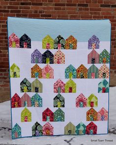 """Suburbs Quilt   Kona Solids and Tula Pink Voile, plus a blue leopard print binding   63"""" x 73"""""""
