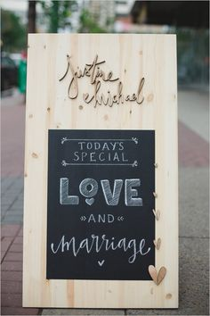 Cute wooden chalk board love sign. Design: Justine Ma ---> http://www.weddingchicks.com/2014/05/21/two-guys-bow-ties-500-giveaway/