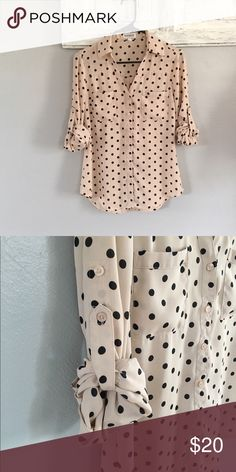 Blush with black polka dots button down I love this shirt, I wish it fit me!!! The main color of this shirt is blush or tan, It looks different in different lighting. Tie up sleeves to make them 3/4 length or keep them down for long sleeves! Only worn once. Express Tops Blouses