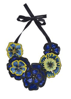 Full Bloom Necklace. Beautiful and vibrant pansies adorn this corsage style, hand beaded necklace from Forest of Chintz perfect for making a bold statement.  Features bugle beads, sequins and crystals on a metal adjustable chain. Wear this dramatic piece with an LBD or jumpsuit and heels; or dress up a simple tee. Perfect for cocktails. #fashion #style #jewelry