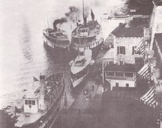 Vessels vie for dockage in front of the Cornwall Brothers Store, once a center of commerce in Alexandria Bay. In the forefront is the Thousand Islands House, built in 1873. Just downriver stood the Crossmon House and behind the store was the Marsden House. Alexandria Bay, Thousand Islands, Historical Images, House Built, Cornwall, River, History, Painting, Historia