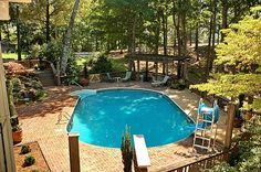 Swimming Pool Landscape Design- i like the small pool perfect for our size back yard!