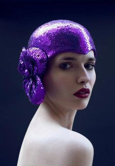 Looking at this Casque by Estelle Ramousse we are in awe of her beautiful craftmanship moulding the helmet perfectly to the head shape.  Covering and trimming in purple sequins was no mean feat. This is a fine example of Estelle's work which you can view at her atelier next time you are in Paris.