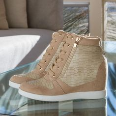 The Jojo wedge sneaker is perfect for any street style outfit. It adds a girly and sporty touch to your look. #ShoeDazzle #streetstyle #neutral #wedge #sneakers