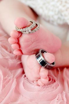 Not necessarily with the flower underneath, but baby toes & wedding rings is cute!