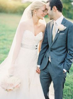 Sash, pastel colors, grey suit, veil. Yes. Yes.