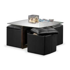 Squared Away. Combining snazzy visual elements with unusual function, the Neera collection offers a new take on multitasking. The coffee table's overlapping legs provide modern appeal, and the cube ottomans boast rich black polyurethane with contrast stitching. Slide the ottomans out for convenient footrests or tuck them away for a neat look - all while you keep items stored inside. Set includes coffee table with four storage ottomans, as shown.