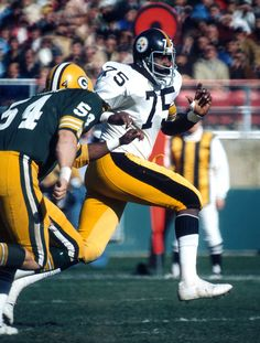Joe Greene  Pittsburgh Steelers Hall of Fame defensive tackle Joe Greene (75) tries to get past Green Bay Packers center Larry McCarren (54) during a 16-13 Steelers victory on October 26, 1975, at Milwaukee County Stadium in Milwaukee, Wisconsin. (Photo by Vernon Biever/NFL Photos)