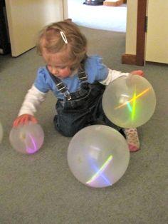 Glow sticks in balloons ... This looks fun!