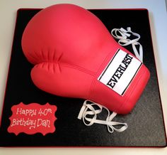 Custom cake shaped as boxing gloves.