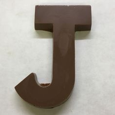 The letter J made of milk chocolate. Chocolate Letters, Letter J, Milk, Products, Gadget