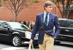 Great use of blue with blazer and spread color shirt. Good color accents with tie and pocket square. Pants add a great contrast to all the blue