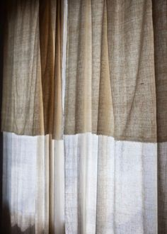 puddled linen curtains (drapes), will need to allow for this do