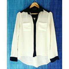 HPForeign Exchange Button Down Blouse Excellent condition. True color is off white with navy blue accent (which looks black in the photos). Runs big, can fit up to one size S-M. Although this shirt is in impeccable condition, there is a tiny pen mark as shown in the second photo, barely noticeable.   Make me a reasonable offer or bundle to save :) Foreign Exchange Tops Button Down Shirts