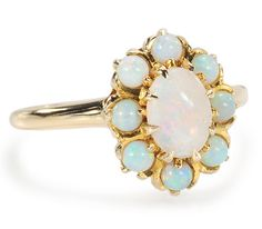 Full Bloom: White Opal Cluster Ring - The Three Graces