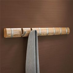 Umbra Flip 8 Hook Natural Large modern designer coat rack by Umbra A whole line of these would be sweet.
