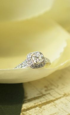 Let the victorian halo ring brighten your days and your decades.