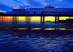 Brighton Piers - acrylic painting on canvas by David Williams. Giclee prints available from www.southdownsgallery.co.uk