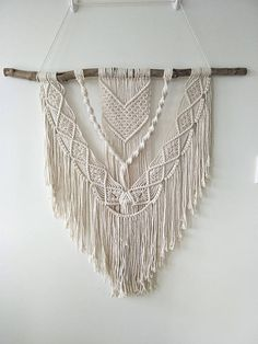 Hang in the lounge,living, bedroom or anywhere else you would like a decorative bohemian piece. full length ( from top of hanging rope to bottom) - 130 cm full width (piece of wood)- 100 cm macrame length- 100 cm macrame width -75 cm PLEASE NOTE THIS HANGING HAS SOLD AND I WILL