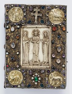 Precious Gospels of Bernward front cover (recreated) ca. 1015/refurbished ca. 1194 Culture: German (Hildesheim) Medium: Covers: silver, gilded silver with niello, filigree, semiprecious stones, and late 10th-century Byzantine (Constantinople) ivory on wood foundation; Manuscript: tempera, gold, and silver on parchment MET