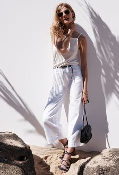 Constance Jablonski wears White Wide-Leg Crop Jeans, High-Neck Apron Tank  and 38cfa7a63733