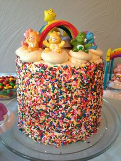 i like the sprinkles on this cake.  would be a simple and easy decoration for the sides of a kids cake.