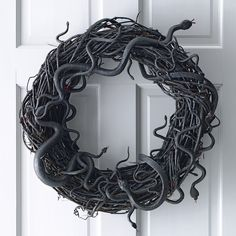Dreadfully sophisticated and shockingly fun, a wreath wriggling with snakes hung on the front door gets Halloween off to a screaming start.