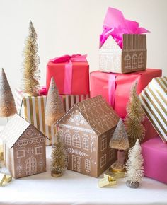 Take your gift wrapping to the next level by making these adorable gingerbread house boxes.