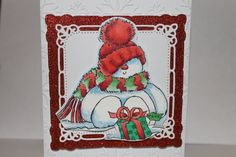 My favorite snowman stamp by Penny Black (I think??)  A little stickles to bling him up after coloring with copics.  Background is a spellbinders die.