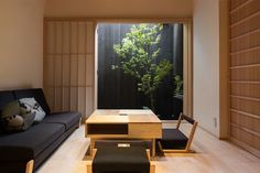 Built more than a 100 years ago, these two traditional townhouses in Kyoto were restored and transformed into modern, clean-lined serviced apartments.
