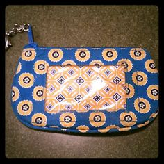 Vera Bradley ID keychain Vera bradley ID keychain, clasp on the side, front pocket to show id, pocket inside to separate money and cards, small mark under the vera bradley on the backside (visible in picture), usual wear and tear Vera Bradley Bags Clutches & Wristlets