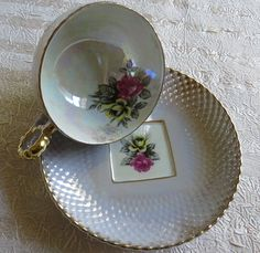 Vintage Blue Iridescent Tea Cup and Saucer with Rose Bouquet