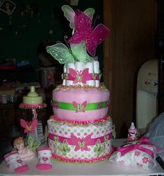 Butterfly Diaper Cake: This is a bright and cheerful pink and green, Butterfly Diaper Cake!   Here is how I made it:  For the center of the diaper cake I used baby bottles. This