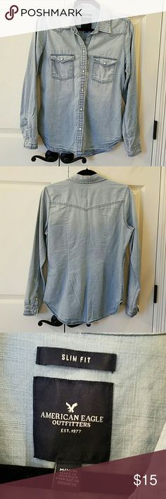 AEO Chambray Shirt EUC Soft, lightly distressed, long sleeve shirt.  Snaps down front, on pockets and at cuffs.  Only worn once.  No flaws. American Eagle Outfitters Tops Button Down Shirts