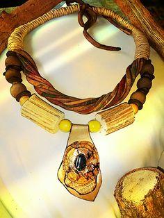 Biojoia trabalhada em: Cordão cipó,cipó,pedra hematita,cordão de malha,bolas madeira das e cascas de Côco.