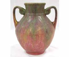 """Roseville Carnelian II Double Handle Handle Vase 7 1/2\"""". May have two small nicks at base. Calcium Buildup inside. No other Cracks, or Repairs."""