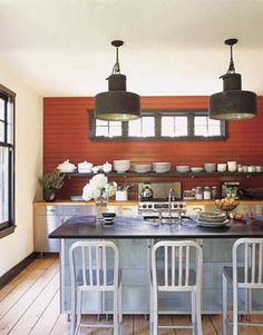 love the layout of this kitchen-- the long low single shelf along the back wall.  Love the stainless cabinets paired with butcher block