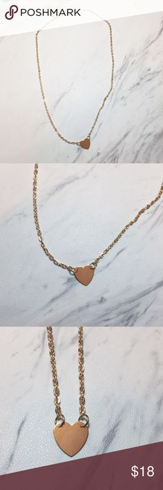 Heart Necklace Gold tone heart necklace!   All Pineapple.PalmBeach jewelry comes packaged on crisp white packaging and tucked carefully into white chiffon pouches ready for you or a friend to enjoy!   Bundle discount available!  🍍Suggested User! 🍍5 Star Rated Seller!  🍍Same or next day shipper! 🚫No trades! ❌No half price offers Pineapple.PalmBeach Jewelry Necklaces