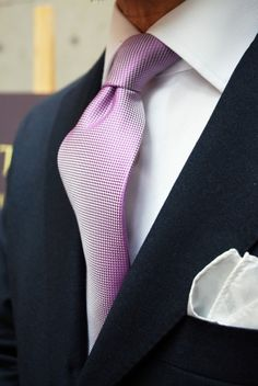 soft lavender color coupled w/solid white shirt and a white cotton pocket square used to accesorize this