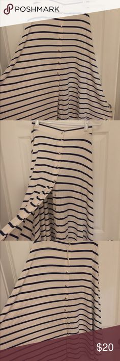 ASOS striped midi skirt NWT ASOS navy and cream midi skirt with snap closures in size 2. Skirt has plenty of stretch and is flowy. ASOS Skirts Midi