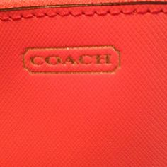Coach make up bag Like new condition. Watermelon/ coral colored. 3 pockets inside. Coach Makeup