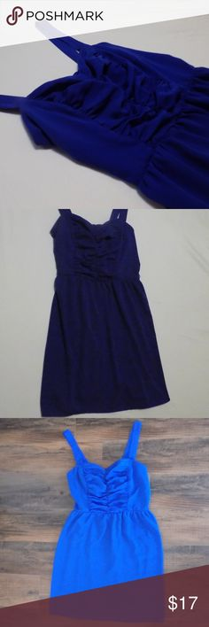 Like new Blue dress size L Juniors Like new dress!  Only worn once, to a wedding.  It is super lightweight and breathable.  The length landed just above my knee.  The design on the top portion is very form fitting and makes every curve flattering. Dresses Midi