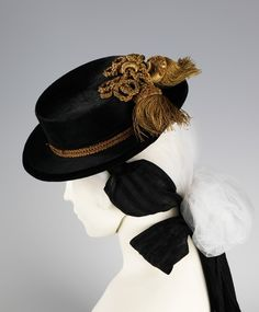 """Hat via The Costume Institute of The Metropolitan Museum of Art """"This style is known as a sombrero cordobés, a form that originated in the 17th century among Andalusian field workers, the stiff brim functioning to shield the wearer from sun and rain. It later became associated with Flamenco singers (cantaores) , horseback bullfighters (rejoneadores), and Latin equestrian apparel. The sombrero cordobés or Cordoban hat has become as iconic in Spanish culture as the mantilla and large ..."""