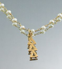 gold lavaliere necklace with seed pearls