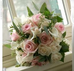 ivory and pale pink roses, and miniature calla lilies