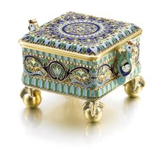 A silver-gilt and cloisonné enamel box, Ovchinnikov, Moscow, 1880, polychrome enamelled with scrolls and stylised flowers on stippled grounds within geometric borders, the two handles formed as cockerels, clawed ball feet.