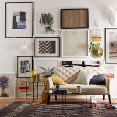 Mirrored coffee table in an eclectic living space-love the sofa, the art and the rug