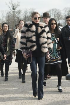 On the streets of Paris, Olivia turned heads in a striped fuzzy jacket that was equal parts cozy and chic.
