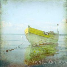 This would be gorgeous on a wall, alone, with only the hints of blue, beige and white in the room.  The Yellow would be the accent.  Just love the serenity of this!!!  Vintage Yellow Boat Beach Print  Home Decor by SevenElevenStudios, $25.00